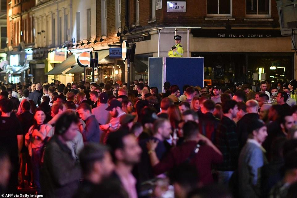30403202-8490751-A_policeman_keeps_watch_over_the_large_crowds_that_gathered_on_t-a-6_1593930305822.jpg